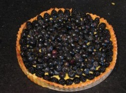Blueberry tart with lemon curd and a goat cheese crust